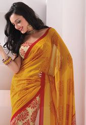 This mustard and cream faux georgette saree.   This looks like a fun way to mix up the wardrobe...