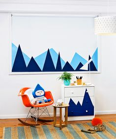 Paint a roller blind with a graphic motif to brighten up a kid's bedroom.