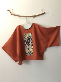 over sized orange linen top with vintage kimono panel ( Japanese floral) note: Each panel is taken from an actual kimono and sewn on. ************** This one of the kind panel shows interesting details of floral print Super roomy width with 60 room, fits all sizes including plus size. ***********