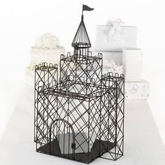 This dreamy black metal replica of an enchanted castle makes for a beautiful wedding gift card holder. Cards can be easily slid between the bars above the front door of the castle. A latch by the fron