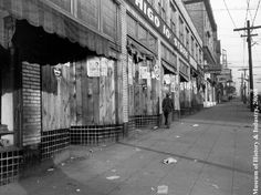 Seattle Post-Intelligencer Collection. Jackson Street block showing vacant stores after evacuation. Museum of History and Industry, Seattle, Washington.