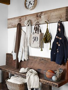 Fun rustic mudroom idea - just add simple hooks to a stained plank with simple bench below (no need for back). The stain (color, value/depth) is great = warm, natural.