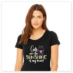 """When you're a cat lover, everything about them makes you happy. This adorable """"Cats are the Sunshine of My Heart"""" tee sums that sentiment up purr-fectly. Super-soft, ultra-comfortable shirt in a rich black color is made of 50% poly, 25% combed and ring-spun cotton and 25% rayon. Design exclusive to Zee & Zoey's Cat Creations!"""