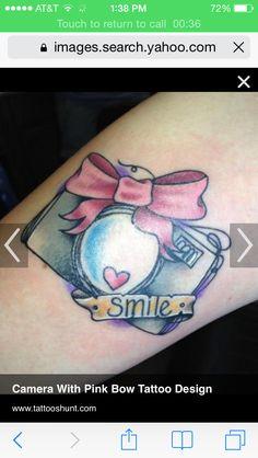 Camera with bow tattoo