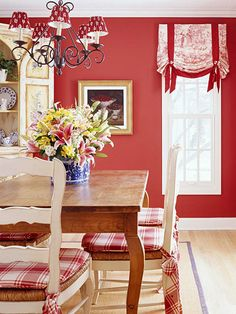 Mix Types of Patterns: Cottage style has quintessential patterns that help define it. Choose three to mix within a room to create a look you'll love. Plaid seat cushions, a toile Roman shade, and a country French floral on the lampshades create a playful cottage look in this dining room.