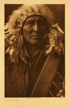 """""""Bread"""" was an Apsaroke-Crow chief. """"Bread (Mahuwush) was born in 1863. He was a Mountain Crow of the Whistle Water clan. His first war experience came under Young Wolf Calf, when the party captured a hundred horses from the Piegan."""" -Curtis. Photograph 1908"""