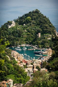 Portofino, Italy. Lighthouse beyond the hill crest