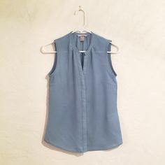 H&M button up blouse This sleeveless, button up blouse from H&M is sea foam in color and a size 6.  Worn a handful of times and in excellent condition.  Please no trades or PP.  All reasonable offers considered.  Thanks for looking! H&M Tops Blouses