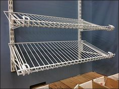One might initially think this part of an Open Wire Closet Storage System, but none was displayed nearby, and the stout construction, dual-mounting, and heavy gauge wire were more typical of store ...