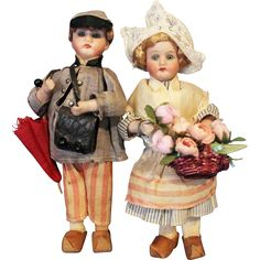 This is a nice little pair a Bisque Boy and Girl Doll  with candy container bodies. The dolls are 8 inches tall, with bisque socket heads they are