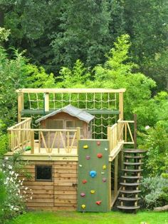A massive wooden playhouse with a fun rope climbing net!