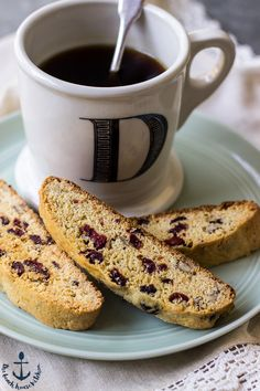 This Cranberry Orange Cornmeal Biscotti with Pecans is the perfect complement for your morning cup of tea or coffee. This crisp cookie studded with pecans and cranberries is sure to become a fall favorite!