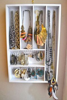 A wood utensil organizer, add hooks and becomes a neat place to hang jewelry!