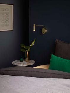 The Enna Matt Gold interior wall reading light by Astro Lighting.