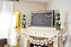 First Birthday Mantel Decor - love the Chalkboard + Photo Garland