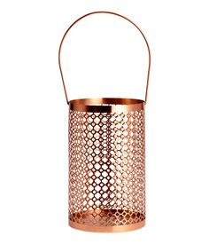 Candle lantern in metal with a perforated pattern. Handle at top. Diameter 5 3/4 in., height 8 1/2 in.