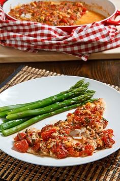 Cod Baked in a Tomato and Feta Sauce/We loved this. I did not have fresh parsley or dill so I used dry and cut down on the amount. Did not use the ouzo. Great dinner that I will make again.