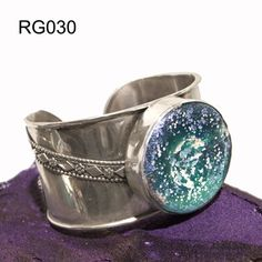 Sterling silver bracelet with Roman Glass by Ben-Zion David...workshop in Tel Aviv...he also does beautiful gold filigree ancient yemenite work and motifs