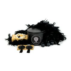 The beautiful burlesque gift pack, featuring  nipple-covers, pearl belt, feather boa and candles. For the showgirl in you.