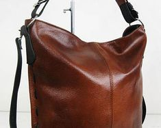 Women do have a craze for bags and they most often love to carry it to every place they visit. Leather Backpack Purse, Leather Hobo Handbags, Leather Laptop Bag, Brown Leather Purses, Leather Bag, Hobo Purses, Large Crossbody Bags, Beautiful Handbags, Convertible Backpack
