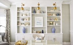 Experiencing shelfie envy? Learn how to successfully style your shelves now on the blog thru [LINK IN PROFILE]  One of our go-to shelf inspirations is this gorgeous home office designed by @sitamontgomeryinteriors featuring our chinoiserie ginger jars! #kathykuohome #interiordesign #kkhdesignwins #office #homedecor