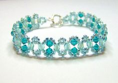 An elegant aqua and teal swarovski bracelet made using blue zircon swarovski bicones, light teal AB czech firepolish and light aqua AB seed beads and finished with a silver plated toggle clasp.  Length of bracelet is 20.5 cm (8.1 inches) which is comfortable for a 6.5 inch wrist and the width is 1.2 cm (0.5 inches)  If you would like this made in a different size, I will be very happy to make one for you at no extra cost, please let me know  If you would prefer a magnetic clasp, or lobster…