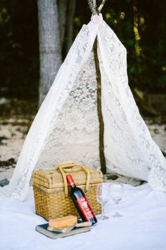 EASY to get lace curtains from Goodwill to create a simple boho gypsy hippie fort with a branch... picnic