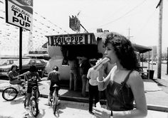 Sigourney Weaver eating a hot dog outside Tail o' the Pup in Los Angeles, date unknown~♛