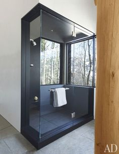 LOVE that shower with the outside/inside vibe - maybe not so much black. The shower is clad in Zimbabwe black granite.