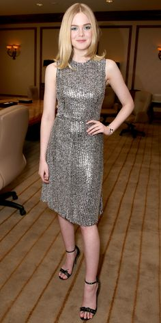 Elle Fanning looked out of this world in a chainmail metallic sheath dress. She finished the look with a winning blowout and embellished black sandals.