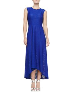 deep blue dress with small hi-lo skirt, zig-zaged fabric back and...cap sleeves minus the sleeve