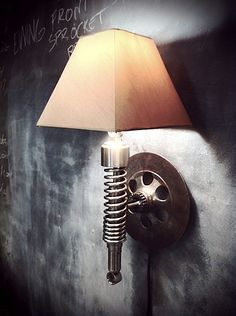 Custom bike shop Classified Moto puts some of its surplus parts to good use by turning them into lamps. The parts come from 70s and 80s Japanese motorcycles and still bear dings and dents from use.