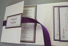 beautiful cream and eggplant wedding invitation.