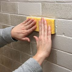 Fireplace makeover using sponges to repaint bricks, thought this may be a good way to fix the bricks downstairs. cut the sponge to match the brick size, makes it easier.