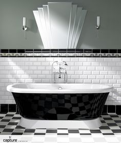 Art deco masterpiece! Black free standing roll top bath on black and white checker board floor tiles. White metro wall tiles complete with decorative pencil profile. Muted green walls with a glamours period mirror. Product photography by http://capture.setvisions.co.uk/Portfolio