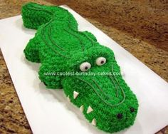 Homemade Alligator Cake: I made this Alligator Cake for my niece's 12th birthday. The curvy tail is cut from half of a bundt cake and pointed at the end. The body and head was