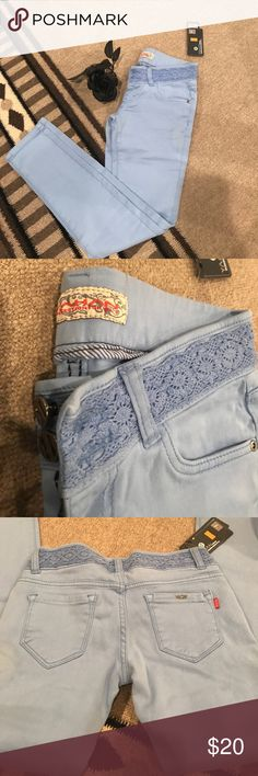 YAHAN baby blue skinny jeans Baby blue jeans with a crochet detail on the waist. Skinny and NWT ultra soft and stretchy. Says size 29 but these are more like size 24/25. YAHAN Jeans Skinny