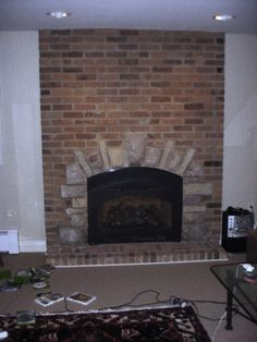Brick fireplace with stone surround