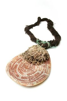 Aboriginal Artist Unknown, An Engraved Pearl Shell, Western Australia, Riji, Jakoli | Incised pearl shell, red natural earth pigment, human hair string, cotton fibre