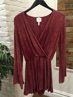 Rust colored perfection. This romper is so soft you will want to wear it all the time!  Lovely bell sleeves give it a little extra flare! $50 #ShopALB #ApricotLaneTS