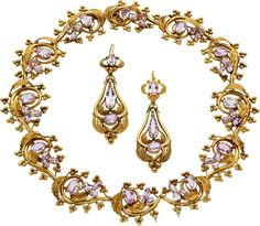 Georgian Pink Topaz, Gold Jewelry Suite, French The demi parure includes a necklace featuring oval and pear-shaped pink topaz weighing a total of approximately 34.40 carats, set in textured 15k gold, completed by pendant wires and clasp; together with a matching pair of earrings having detachable drops enhanced by oval and pear-shaped pink topaz weighing a total of approximately 11.10 carats, set in 15k gold, completed by ear wires, French Hallmarks