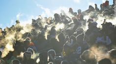 Body heat creates little clouds of steam off fans at TCF Bank Stadium in Minneapolis, Minnesota.