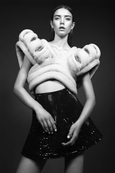 Sculptural Fashion - couture knitwear with structured symmetry and exaggerated 3D shoulder detail // Stine Ladefoged