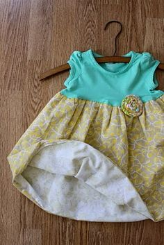 DIY onesie dress. This is cute, but i would want to try using the whole onzie instead of cutting it. Not sure it would work; worth a try...