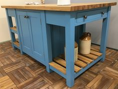 Freestanding kitchen island incorporating two back-to-back double cupboards & slatted end shelves at both ends. Made in 4 Parts (plus worktop) it will fit through any standard width doorway for easy re-assembly once in place. Here the island is fitted with a 40mm thick Oak Worktop but other hardwood options are available. Shown here finished in Fired Earth 'A Day by the Sea' but any size or colour can be made to order. Size Shown L:1800mm x H:910mm D:960mm