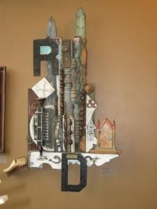 """Here's a wall assemblage I made from old broken furniture pieces, house pieces, letters, """"stuff""""."""