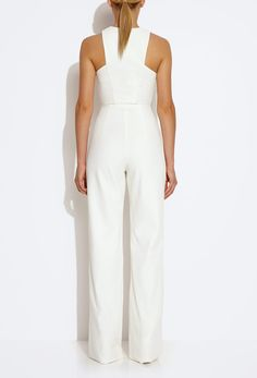 The Crane Jumpsuit in cream features a contrast panelled bodice with a concealed front zip. Cut out shoulders, wide leg trousers.  From the AQ/AQ SS15 Collection.