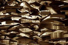 """Curtain of books - 24h du livre à Romainmôtier, édition 2008.  A detail of Jan Reymond's latest book sculpture, """"Rosace"""". [by timtom.ch, via Flickr]"""