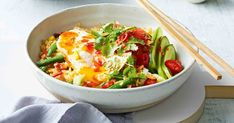 A popular Indonesian stir-fry, the whole family will love these bowls of goodness. Fried Shallots, Sweet Chilli Sauce, Nasi Goreng, Sliced Tomato, Sausage Rolls, Cheap Dinners, Fresh Coriander, Tray Bakes, Cheddar