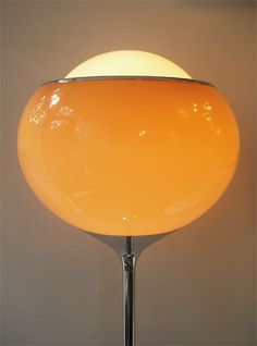 "The ""Grande Bud"" by Harvey Guzzini, this big pole light with huge globe on top has become a well-known design icon of the 20th century. These lamps evoke a warm atmosphere of light thanks to the diffused material of the spheres.    Designer Harvey Guzzini.  Manufacturer Guzzini, Italy"
